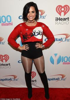 Legs 11... out of ten! Demi Lovato showed off her incredible figure at the Jingle Ball in ...
