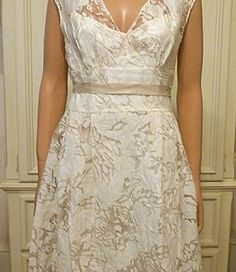 """NO Tag   Never Worn - Has Side Zipper under left arm  Ribbon Belt  Color is: Ivory and Beige  Fabric - Cotton  Bust..32"""" - 36""""  Waist..26 - 28""""  Hips..36""""  Length..approx 32.5"""""""