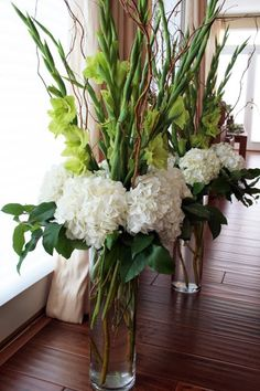 dramatic arrangement of white hydrangea, curly willow, and green gladiolus Church Flower Arrangements, Church Flowers, Wedding Flower Arrangements, Tall Floral Arrangements, Table Arrangements, Gladiolus Wedding Flowers, Wedding Alter Flowers, Gladiolus Arrangements, Centrepieces