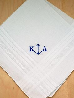 Personalize this nautical inspired mens handkerchief with a two letter monogram. Perfect for either a couple's monogram or an individual's monogram. The handkerchief is cotton and measures approx 17 x 17 square.