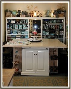 Love this craft room organization and the unity of color. Makes it look cleaner and organized. #Studio #WorkSpace