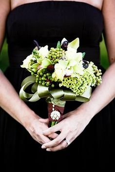 The bridesmaids' green bouquets popped against their brown dresses. The brooches on their bouquets were earrings purchased from Forever 21.