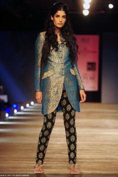 Ericka Packard showcases a creation by designer Monisha Jaising on Day 2 of Delhi Couture Week, held in New Delhi, on August 01, 2013.