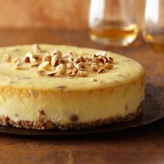 Decadent Hazelnut Cheesecake, Almond extract and hazelnut liqueur give this cheesecake a wonderfully earthy, nutty flavor. Toasted hazelnuts on top add contrasting crunchiness.