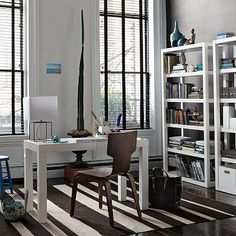 Love the striped rug, parsons desk and bookshelving, and the bentwood chair