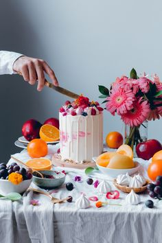 White Cake filled with peaches, raspeberry jam, swiss meringue buttercream and white chocolate drip