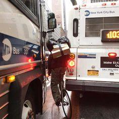 Bike messenger on a tight spot