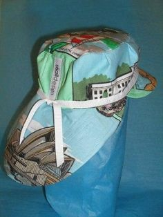 Just for boy babies - retro sunhat, adjustable for fit, made from souvenir teatowel. Sweet as. No two the same.