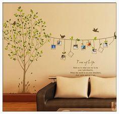 Fotos na parede com adesivos. Árvore.
