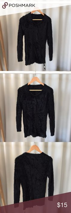 Black Fuzzy Sweater Fuzzy sweater! With a V-neck line. Soft and comfortable. Stretchy material. Fits like a S/M Sweaters V-Necks