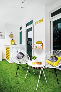 The semi-sheltered patio, located conveniently beside the condominium pool, is an inviting garden-like space thanks to the faux grass flooring.
