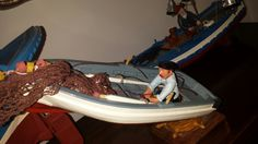 Marinero en bote auxiliar. Fishman