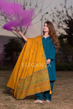 Teal Blue Swiss khaddar suit with stone mustard buttons on neck. Shalwar is having broad silai panchas. The suit is paired with Mustard Block printed shawl. Stylish Dresses For Girls, Stylish Dress Designs, Trendy Clothes For Women, Simple Dresses, Trendy Outfits, Casual Dresses, Fashion Dresses, Simple Pakistani Dresses, Pakistani Fashion Casual