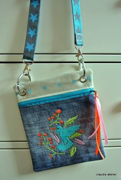 Embroidered zipper pouch with ribbon trim - very pretty :)