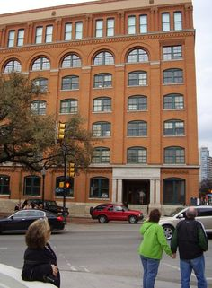 The Book Depository in Dallas, TX. Site where Harvey Oswald shot out of the 5th story window down onto the Presidential motorcade & assassinated President John F. Kennedy.