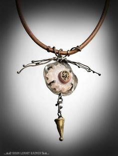 What does this mixed media amulet remind you of? An Amulet in Pale Earth Tones by Susan Lenart Kazmer
