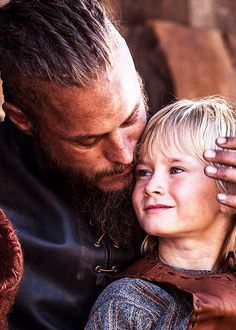 Ragnar Lothbrok with his son Hvitserk - Travis Fimmel and Cathal O'Hallin in Vikings (TV series).