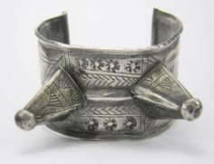 A double spiked rare cuff from Jbel Bani, Morocco. At the edge of the Anti Atlas lies the Jbel Bani region. The word 'Jbe'l means mountain, and the region is harsh and rocky. These iconic dual spiked bracelets are a rarity from this region.