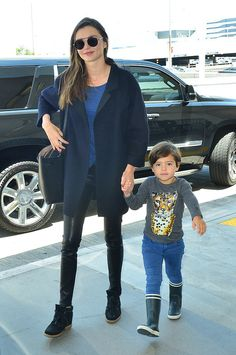 """runwayandbeauty: """"Miranda Kerr dons leather leggings and an oversized navy coat as she arrives at LAX airport with son Flynn (Saturday 06/06/2015). """" www.fashionclue.net   Fashion Tumblr, Street Wear..."""