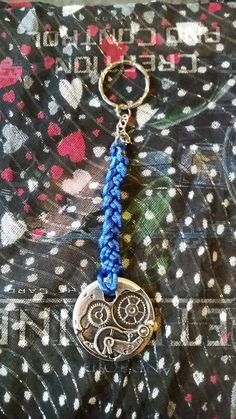Check out this item in my Etsy shop https://www.etsy.com/uk/listing/253565679/silver-steam-punk-cog-weave-keychain