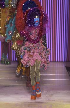112 photos of John Galliano at Paris Fashion Week Spring 2003.