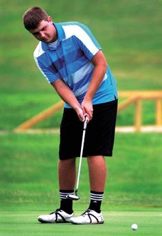 Gary Charton of New Philadelphia sinks a putt during the First National Bank Junior Golf Tour stop at Green Valley Golf Course in New Philad...