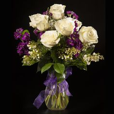 A stunning color combination of deep purples and whites will spread love or laughter. A mix of lush white roses and purple stock adorned with a pretty ribbon create the perfect garden look any mother would enjoy. Purple Spring Flowers, All Flowers, White Roses, White Flowers, Prairie Village, Garden Landscaping, Landscaping Ideas, Flower Company, Mylar Balloons
