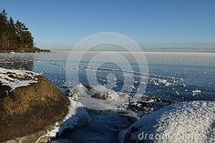 Early morning on a winter day, blue sky and sun over frozen Lake Superior, snow-covered rocks and shiny blue ice surface and with white snow and ice pieces. RAW file available. Images Of Frozen, Stony Brook, Snow And Ice, Lake Superior, Winter Day, Great Lakes, Early Morning, Toronto, Rocks
