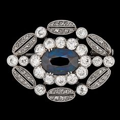 A blue sapphire and diamond brooch mounted in platinum and gold  c,1930's Art Deco