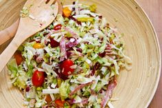 Savory salami chopped salad with baby heirloom tomatoes and red wine vinaigrette.
