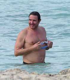 Rocking it: Duran Duran frontman Simon Le Bon enjoyed another chilled out day in Miami alo...