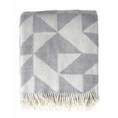 Tina Ratzer Merino Blanket: Tina Ratzer is a Copenhagen based designer whose work explores colour and geometric patterns.These blankets or throws are ideal for adding style and colour to a sofa or bed.Made from beautifully soft and warm 100% new Merino Wool. Available in both Twist a Twill design and New Focus on Twill design (The bigger shaped pattern) Please specify.