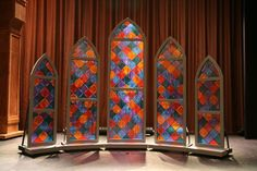 Interesting concept of free standing stained glass window -- could be a way to incorporate multiple set ideas wedding stained glass windows