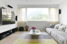 Interior Design by YC Chen of hoo | Photography by hoo |  Modern Sanctuary | Mid-Century Modern Apartment in Hong Kong | Living Room | Great Room | Modern Living Room | Mid-Century Modern Living Room