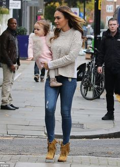 Mummy and daddy: Tamara, whose father is Formula One boss Bernie Ecclestone, looked stunni...