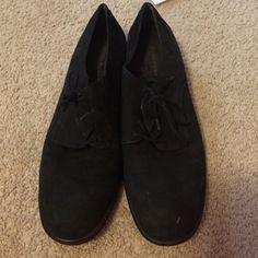 Black shoes Super cute and extremely comfortable. Some marks and dirt (see pics) and on back of left heel. Otherwise in good condition, and soles show little signs of wear. Suede like material on outside. Leather upper Rockport Shoes Flats & Loafers