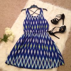 Blue Pattern Dress This dress has a partial open back with straps! (The back makes a soft v) Also has elastic waist and yellow and white in the pattern! Never worn! My Michelle Dresses
