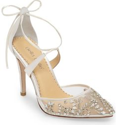 Hand-sewn beads and crystal embellishments sparkle and shine on this glamorous ankle-tie sandal perfect for your special day.