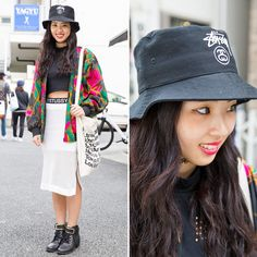 18-year-old Akari on the street in Harajuku wearing a bucket hat and skirt by Stussy Women JP, a FIG&VIPER crop top, a resale jacket, an American Apparel tote bag, tattoo necklace, and ankle boots.