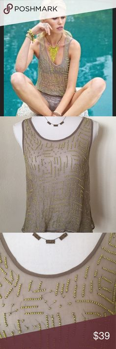 Chan Luu Beaded Chiffon Blouse Size Small NWT Gorgeous beaded tank from jewelry and fashion designer Chan Luu, size Small   Hand beaded 100% viscose Dry clean only  New with tags attached I can see a place or two where a single bead might be missing  But difficult to tell with random bead placement  Overall excellent condition   Georgeous statement piece, like wearing a little work of art! Chan Luu Tops Blouses