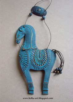 "Suspension ""HORSE""  black and bronze chamotte clay, acrylic  I am taking the posts under the pictures and repeating them on the pins. but I do believe they have them mixed up. this looks like the blue one, LOL"