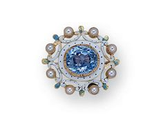An Antique Sapphire, Enamel and Pearl Brooch, circa 1890. The petite design centering an oval sapphire amid a conforming surround decorated with black and white pique enamelling, to a similarly-enamelled scrolling garland accented by tiny pearls and green enamelled foliage, in 18k and 14k gold.
