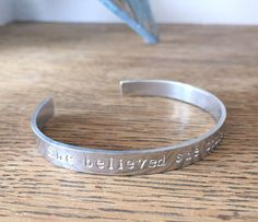 A hand stamped aluminium cuff bracelet/ bangle with a inspirational quote or personalised words of your choice.