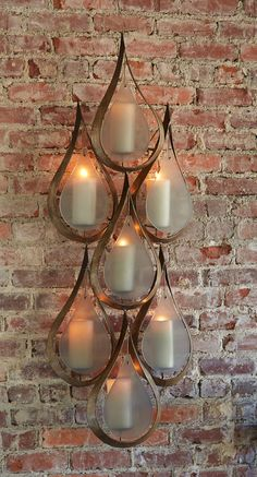 We love this candle wall sconce! Adds warmth and visual interest.