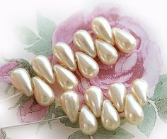 Hey, I found this really awesome Etsy listing at https://www.etsy.com/listing/115134865/faux-pearls-cream-teardrops-czech-glass