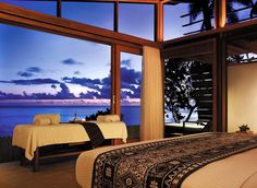 Tropical Master Bedroom with Natural light, Indoor/outdoor living, Spa, High ceiling, Natural wood framing, Massage table