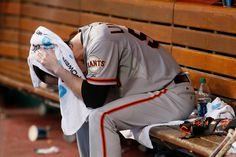 San Francisco Giants pitcher Tim Lincecum sits on the bench after being taken out of the baseball game against the Cincinnati Reds in the fifth inning Tuesday, June 3, 2014, in Cincinnati. (AP Photo/Tom Uhlman)