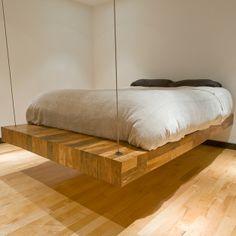 massive wooden slab suspended bed