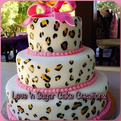 Cheetah print and pink theme baby shower cake! All spots are hand painted with edible paint!
