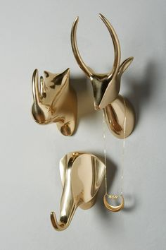 Gleaming Safari Bust. Rhino, antelope, elephant. Handcrafted in cast brass. Shiny metallic gold decor for your walls - add as a sculptural element to your prints wall.